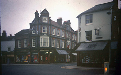 A view taken in the 1960s of WHSmith and Boots on opposite corners at the end of   Duke Street  .    Photo kindly provided by Roy Sadler.
