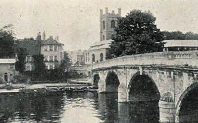 A classic shot of   Henley Bridge   with   Saint Mary's Church   in the distance.